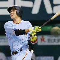 The Giants' Hayato Sakamoto slugs a solo home run against the Pacific League in the fourth inning of Game 1 of the All-Star Series on Friday night at Yafuoku Dome. The Central League defeated the Pacific League 5-4. | KYODO