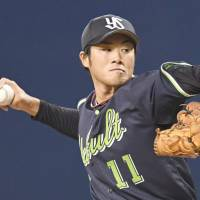 Swallows pitcher Sato earns first win in five years