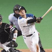 Nakata helps Fighters whittle Hawks' lead