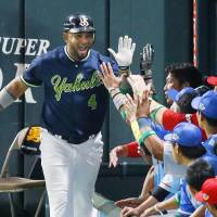 The Swallows' Wladimir Balentien exchanges high-fives with CL teammates after slugging  a fifth-inning home run on Friday. | KYODO
