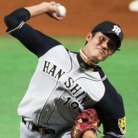 Hanshin Tigers All-Star pitcher Shintaro Fujinami earned the victory in relief for the Central League. | KYODO