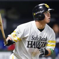 The Hawks' Yuya Hasegawa belts a fifth-inning home run for the Pacific League on Friday at Yafuoku Dome. | KYODO