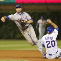 Familia gets out of jam as Mets defeat Cubs