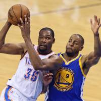 Durant rocks NBA in move to Warriors
