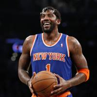 Stoudemire signs with Knicks, retires