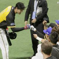 Pacific League All-Star Shohei Otani interacts with fans on Friday at Yafuoku Dome, where Game 1 of the All-Star Series was held. | KYODO
