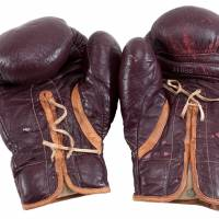 Boxing gloves worn by Muhammad Ali during his March 8, 1971, 'Fight of the Century' in Madison Square Garden against Joe Frazier are pictured in this undated handout photo obtained by Reuters Monday. The gloves are set to be auctioned off in New Jersey Aug. 4. | GOLDIN AUCTIONS / HANDOUT VIA REUTERS