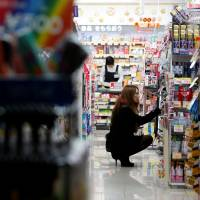 A shopper browses items at a Tokyo pharmacy in this 2013 file image.   REUTERS