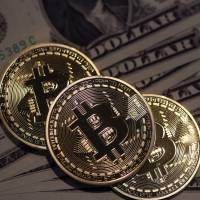 Bitcoin sinks after hackers steal $65 million from exchange
