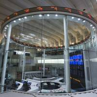 Stock tickers are displayed on the trading floor of the Tokyo Stock Exchange. Thanks to increases in ETF purchases, the Bank of Japan has been prominently boosting its presence in the nation's stock market.   BLOOMBERG