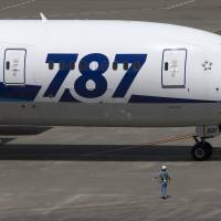 A Boeing 787 Dreamliner owned by All Nippon Airways Co. taxies at Haneda airport in Tokyo last month. | BLOOMBERG