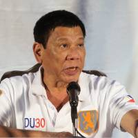 Philippine President Rodrigo Duterte speaks during a news conference in Davao City, in the country's south, on Sunday. | REUTERS