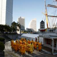 Performers dressed as Pokemon character Pikachu prepare for a parade in Yokohama on August 7.   REUTERS