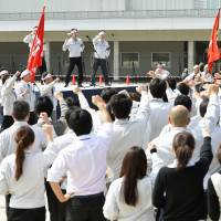 Members of Toyota Motor Worker's Union hold a gathering at Toyota Motor Corp.'s headquarters in Aichi Prefecture during spring wage talks in March. The IMF is so worried about stagnation in Japan that it believes radical incentives may be needed. | KYODO