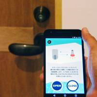 A new high-tech hotel in Fukuoka allows guests to control their rooms via smartphone. | KYODO
