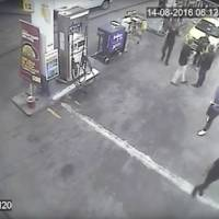 Sunday surveillance video released by Brazil Police shows swimmers from the United States Olympic team appear with Ryan Lochte (right) at a gas station during the 2016 Summer Olympics in Rio de Janeiro. A top Brazil police official said the swimmers damaged property at the gas station. | BRAZIL POLICE VIA AP