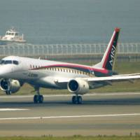 The Mitsubishi Regional Jet is set to head to the U.S. this month for test flights there. | KYODO