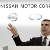Carlos Ghosn, chief executive officer of Nissan Motor Co., gestures as he speaks during a news conference in Yokohama on May 12. | BLOOMBERG