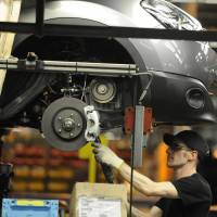 A Nissan technician prepares a Qashqai car at the company's plant in Sunderland, northern England on Nov. 9, 2011.   REUTERS