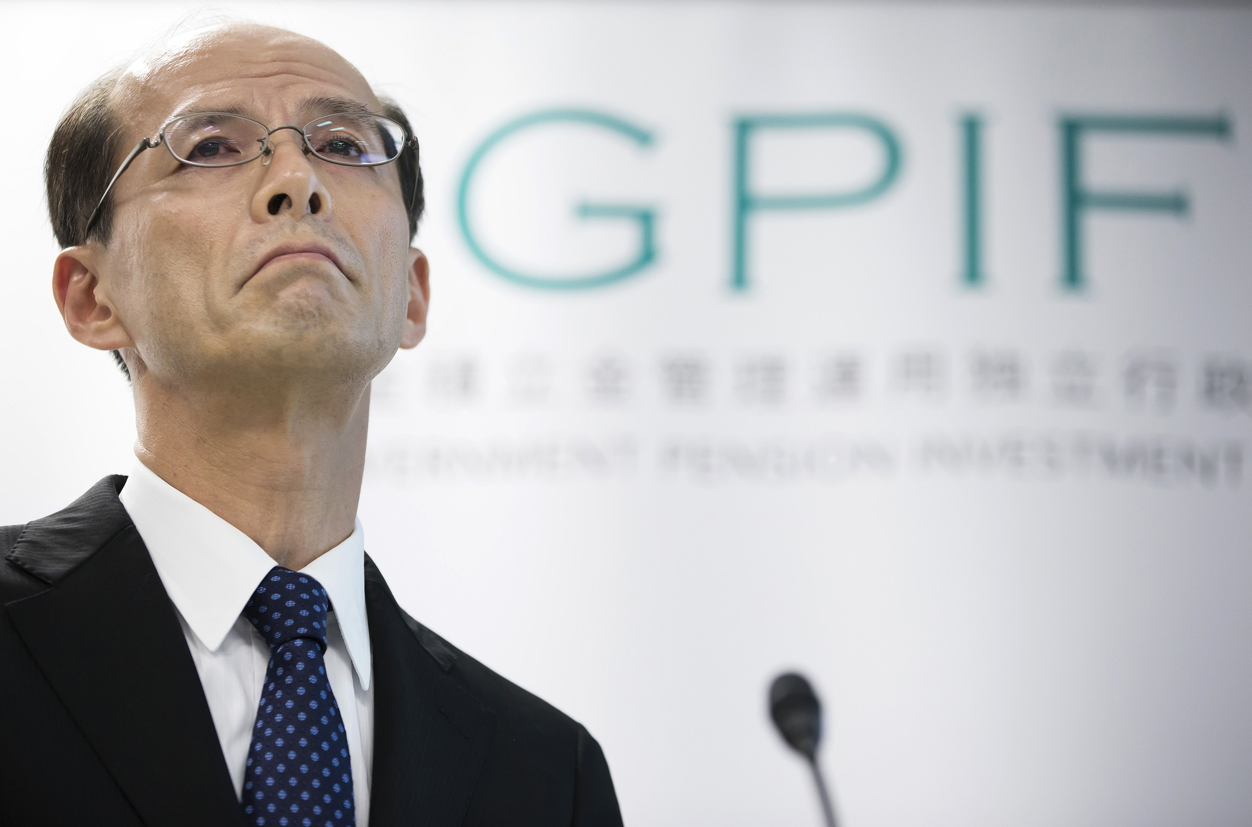 Norihiro Takahashi, president of the Government Pension Investment Fund, pauses during a news conference in Tokyo July 29. | BLOOMBERG