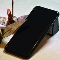 New plastic resembles Japanese lacquerware; NEC says suitable for high-end cars