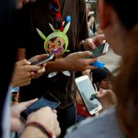 People playing 'Pokemon Go' in Madrid. After weeks of delays, the game is now available in Brazil. | REUTERS