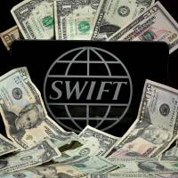 SWIFT discloses more cyberthefts, pressures banks on security