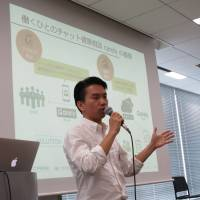 Yota Yamada, CEO of Tokyo-based startup iCare Co., explains his chat-based health counseling business during a meet-up event in Tokyo on July 24.   KAZUAKI NAGATA