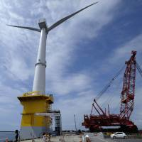A 7-megawatt turbine for a pilot project led by Marubeni Corp. and funded by the government stands at a port in Onahama, Fukushima Prefecture, in June 2015. | BLOOMBERG