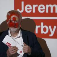 Jeremy Corbyn, leader of Britain's opposition Labour Party, attends the Labour Digital Democracy Manifesto launch in London on Tuesday. | REUTERS