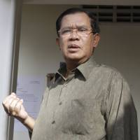 Cambodia PM says potbelly is hurting his golf swing