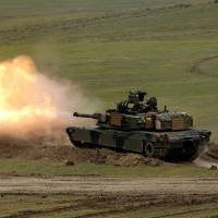 A U.S. Abrams tank takes part in military drills near Vaziani, in former-Soviet Georgia, in May. | REUTERS