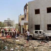 Islamic State suicide bomber kills 54 government recruits in Aden