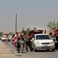 Taliban tightens grip on Helmand province as Kabul focuses on Islamic State