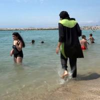 Beach clashes lead to third French burqini ban