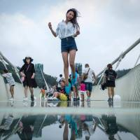 World's longest glass bridge opens over canyon in China