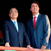 Chinese Premier Li Keqiang meets Canadian Prime Minister Justin Trudeau in Beijing on Tuesday. | REUTERS