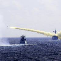 A missile is launched from a Chinese Navy ship during a live-ammunition drill in the East China Sea in this photo released Monday. | AP
