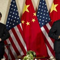 U.S. President Barack Obama and Chinese President Xi Jinping meet at the U.S. ambassador's residence in The Hague in March 2014 on the sidelines of the Nuclear Security Summit. Obama said he and Xi were both 'committed to continuing to strengthen and build a new model of relations between our countries.' | AFP-JIJI