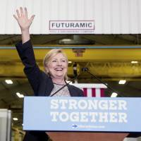 As Trump struggles, Clinton goes on offense to win over GOP fence-sitters