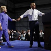 Clinton, Biden double-team Trump on ability to lead, aide's reported cash ties to Russia