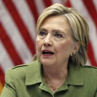 Democratic presidential candidate Hillary Clinton talks with media as she meets with law enforcement leaders at John Jay College of Criminal Justice in New York Thursday.   AP