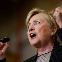 Clinton vows to stand up to China, oppose TPP if elected