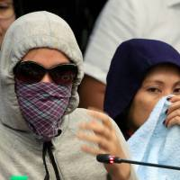 Relatives of people slain in alleged drug-related cases testify at a Senate hearing investigating the killings, in Pasay city, Manila, on Tuesday.   REUTERS