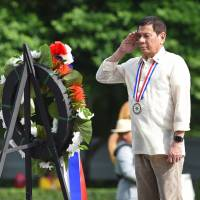 Philippine President Rodrigo Duterte attends a wreath-laying ceremony at a Manila cemetery on Monday, which was marked as National Heroes' Day. | AFP-JIJI