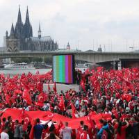 Tens of thousands rally for Erdogan in Cologne, raising tensions as Ankara purge continues