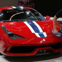 Ouch: Woman in Benz backs onto $290,000 Ferrari while parallel parking