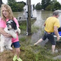 'Historic' Louisiana floods kill at least three; thousands rescued