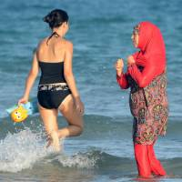 In ruling expected to set precedent, top French court suspends ban on burkini swimsuits