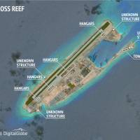 Construction is seen on Fiery Cross Reef in the Spratly islands, in the disputed South China Sea in a June 3 satellite image released by the Asian Maritime Transparency Initiative at the Center for Strategic and International Studies (CSIS) to Reuters on Tuesday. | CSIS ASIA MARITIME TRANSPARENCY INITIATIVE / DIGITALGLOBE / HANDOUT VIA REUTERS
